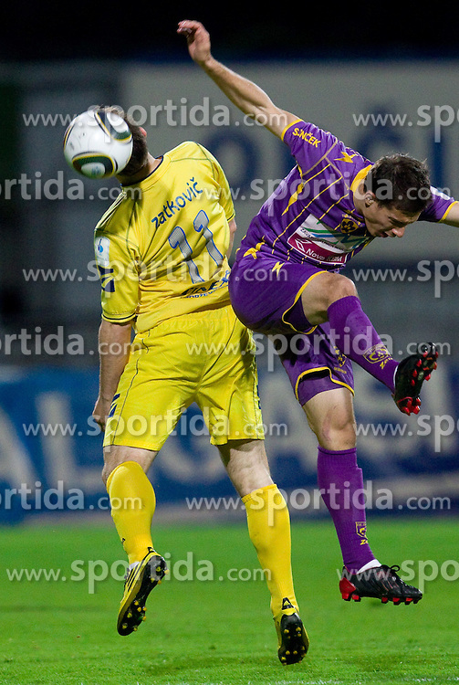 Mitja Zatkovic of Domzale vs Goran Cvijanovic of Maribor during football match between NK Domzale and NK Maribor in 27th Round of Slovenian 1st League PrvaLiga, on April 9, 2011 in Sports park Domzale, Slovenia.  (Photo By Vid Ponikvar / Sportida.com)