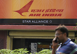 April 27, 2019 - Kolkata, West Bengal, India - A man talks walks past Air India office in Kolkata, India on Saturday, 27 April, 2019. ..The flight operations of Air India were affected since 3:00 am Saturday in India and overseas due to server failure, passengers were stranded. (Credit Image: © Indranil Aditya/NurPhoto via ZUMA Press)