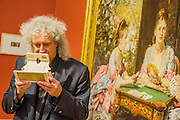 Poor man's picture gallery: Victorian Art and Stereoscopic Photography at the Tate Britain - a rare collection of Victorian stereographic photographs. Lent by Astronomer and Queen guitarist Dr Brian May (pictured - here with Hearts are Trumps by Michael Burr, based on th work by Millais, behind). This is the first display in a major British art gallery devoted to the nineteenth-century craze of three-dimensional photography. It is also accompanied by a book launch with viewer to see the 3-d images. Guy Bell, 07771 786236, guy@gbphotos.com