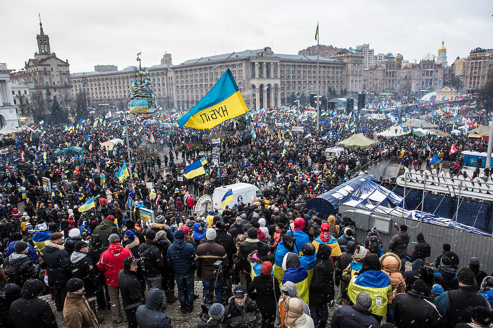 KIEV, UKRAINE - DECEMBER 8: Anti-government protesters hold a large rally on Independence Square on December 8, 2013 in Kiev, Ukraine. Thousands of people have been protesting against the government since a decision by Ukrainian president Viktor Yanukovych to suspend a trade and partnership agreement with the European Union in favor of incentives from Russia. (Photo by Brendan Hoffman/Getty Images) *** Local Caption ***