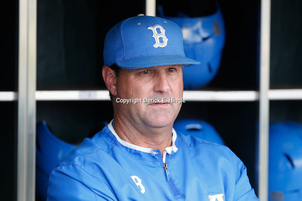 Jun 25, 2013; Omaha, NE, USA; UCLA Bruins head coach John Savage (22) looks on from the dugout before game 2 of the College World Series finals against the Mississippi State Bulldogs at TD Ameritrade Park. Mandatory Credit: Derick E. Hingle-USA TODAY Sports