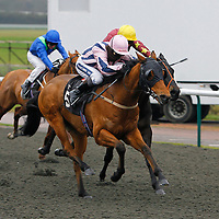 Lastkingofscotland and Hayley Turner winning the 1.20 race