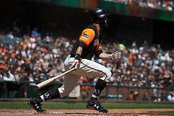 SAN FRANCISCO, CA - AUGUST 26: Brandon Belt #9 of the San Francisco Giants at bat against the Texas Rangers during the first inning at AT&T Park on August 26, 2018 in San Francisco, California. The San Francisco Giants defeated the Texas Rangers 3-1. All players across MLB will wear nicknames on their backs as well as colorful, non-traditional uniforms featuring alternate designs inspired by youth-league uniforms during Players Weekend. (Photo by Jason O. Watson/Getty Images) *** Local Caption *** Brandon Belt