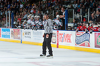 KELOWNA, CANADA - APRIL 25: Bevan Mills, linesman, stands on the ice between the benches of the # of the Kelowna Rockets and the Portland Winterhawks on April 25, 2014 during Game 5 of the third round of WHL Playoffs at Prospera Place in Kelowna, British Columbia, Canada. The Portland Winterhawks won 7 - 3 and took the Western Conference Championship for the fourth year in a row earning them a place in the WHL final.  (Photo by Marissa Baecker/Getty Images)  *** Local Caption *** Bevan Mills;