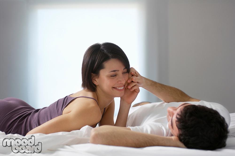 Couple lying on bed