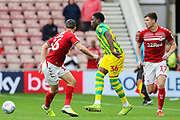 West Bromwich Albion defender Nathan Ferguson (36) plays the ball under pressure from Middlesbrough midfielder Jonny Howson (16) and Middlesbrough midfielder Paddy McNair (17) during the EFL Sky Bet Championship match between Middlesbrough and West Bromwich Albion at the Riverside Stadium, Middlesbrough, England on 19 October 2019.