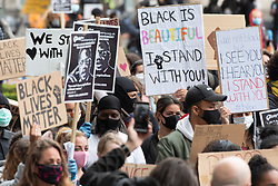 © Licensed to London News Pictures. 06/06/2020. London, UK. Protesters take part in a demonstration in Parliament Square organised by group Black Lives Matter for the American George Floyd who died whilst being arrested by US policemen Derek Chauvin. His death has caused civil unrest in some US cities. Photo credit: Ray Tang/LNP