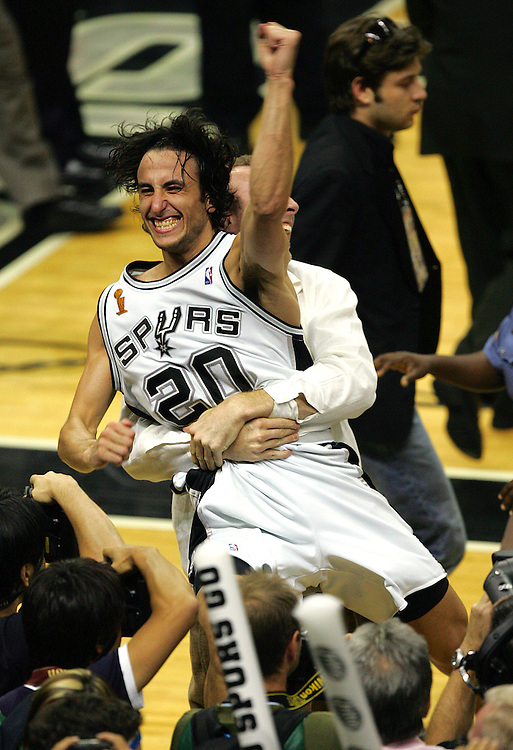 Spurs manu Ginobili celebrates the Spurs NBA Championship after their game 7 81-74 win over the Pistons NBA Finals at the SBC Center in San Antonio Thursday June 23, 2005 . BAHRAM MARK SOBHANI/STAFF
