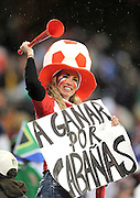 A Paraguay Fan with a Vuvuzela during the 2010 FIFA World Cup South Africa Group F match between Italy and Paraguay at Green Point Stadium on June 14, 2010 in Cape Town, South Africa.