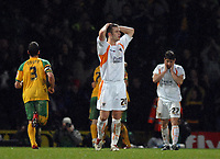 Photo: Ashley Pickering.<br /> Norwich City v Blackpool. The FA Cup. 13/02/2007.<br /> David Fox of Blackpool (C) holds his head in his hands as Norwich celebrate their winning goal