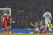 17 Ryan Christie scores goal as he falls during the Betfred Cup Final between Celtic and Aberdeen at Hampden Park, Glasgow, United Kingdom on 2 December 2018.