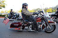 MONTGOMERY, NY.  Motorcycle escort for WWII Veterans and their escorts aboard the Hudson Valley Honor Flight as they leave the Shop-Rite Plaza in Montgomery, NY bound for Stewart International Airport and onward to the World War II Memorial in Washington, DC on Saturday, September 21, 2013.  © www.chetgordon.com