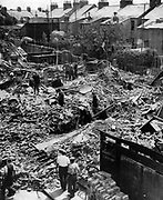 Bomb damage in a Cambridge street after a raid on eastern England by the Luftwaffe (German Air Force) on the night of 18-19 June 1940. A number of houses destroyed, 11 civilians killed and 14 wounded.