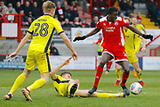 Cheltenham Town defender William Boyle (15) gets a foot in against Crawley Town forward Panutche Camara (28) during the EFL Sky Bet League 2 match between Crawley Town and Cheltenham Town at the Checkatrade.com Stadium, Crawley, England on 24 March 2018. Picture by Andy Walter.