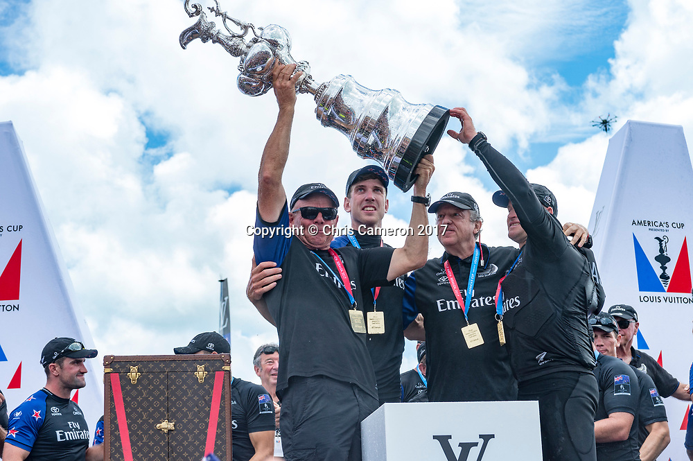 The Great Sound, Bermuda, 26th June 2017. Emirates Team New Zealand CEO holds aloft the America's Cup on stage with Helmsman Peter Burling, Principal Matteo de Nora and skipper Glenn Asby.<br /> 26 June 2017.<br /> Copyright photo: Chris Cameron / www.photosport.nz