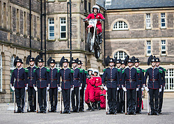 The 1,200 performers that will take part in the 2016 Royal Edinburgh Military Tattoo come together for the first time to rehearse.<br /> <br /> Pictured:The Imps jump over His Majesty The King's Guard from Norway