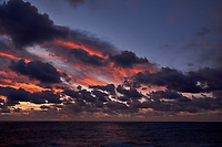 Colorful Dawn clouds over the Pacific Ocean from the deck of the MV World Odyssey. Image 4 of 6 taken with a  Fuji X-T1 camera and 23 mm f/1.4 lens (ISO 200, 23 mm, f/5.6, 1/60 sec). Raw images processed with Capture One Pro.