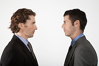 Businessmen face to face on white background