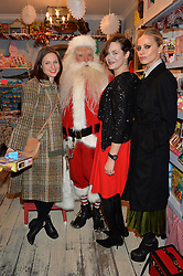 LONDON, ENGLAND 1 DECEMBER 2016:Left to right, Sophie Ellis-Bextor, Father Christmas, Jasmine Guinness, Laura Bailey at the 10th birthday party for the toy shop HoneyJam, 2 Blenheim Crescent, Notting Hill, London, England. 1 December 2016.