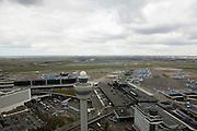 Nederland, Noord-Holland, Haarlemmermeer, 16-04-2008; Schiphol Plaza, plein rond de verkeerstoren, links hiervan de ingang van de luchthaven, het station en het winkelcentrum (het driehoekig begroeid dak);  midden boven: de nieuwe terminal (terminal 3) en daarachter, in de verte, de Zwanenburgbaan..luchtfoto (toeslag); aerial photo (additional fee required); .foto Siebe Swart / photo Siebe Swart