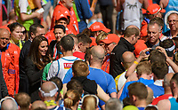 TRH The Duke and Duchess of Cambridge handing medals to finishers on The Mall. The Virgin Money London Marathon, 23rd April 2017.<br /> <br /> Photo: Thomas Lovelock for Virgin Money London Marathon<br /> <br /> For further information: media@londonmarathonevents.co.uk