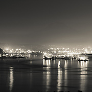 Tacoma by night, with the faint outline of Mt. Rainier - WA