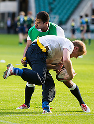 LONDON- UK - 17-OCT-2013- Britain's Prince Harry, Patron of the Rugby Football Union (RFU) All Schools Programme, joins a coaching session at Twickenham Stadium for young people from participating secondary schools across the country.<br />  <br /> Prince Harry delivered a training session alongside Jason Robinson-former England Rugby Player, RFU coaching staff on the Rugby pitch, before heading inside the stadium to meet young people taking part in a kit design workshop, designed to help them take pride in their team colours.<br /> Photo by Ian Jones