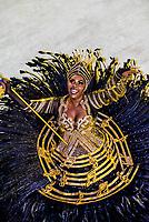 Flag bearer (porta bandeira) in the Carnaval parade of Unidos da Ponte samba school in the Sambadrome, Rio de Janeiro, Brazil.