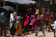 Along with Army-Police and RAB hired goons batter the agitated workers,30th April, 2010. Mirpur,Dhaka, Bangladesh