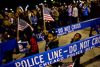 Three young children wave a American flags as supporters take to Chicago's Grant Park for the election night results for the presidential race between Sen. Barak Obama (D-IL) and Sen. John McCain (R-AZ) Tuesday Nov. 4, 2008 Chicago IL.