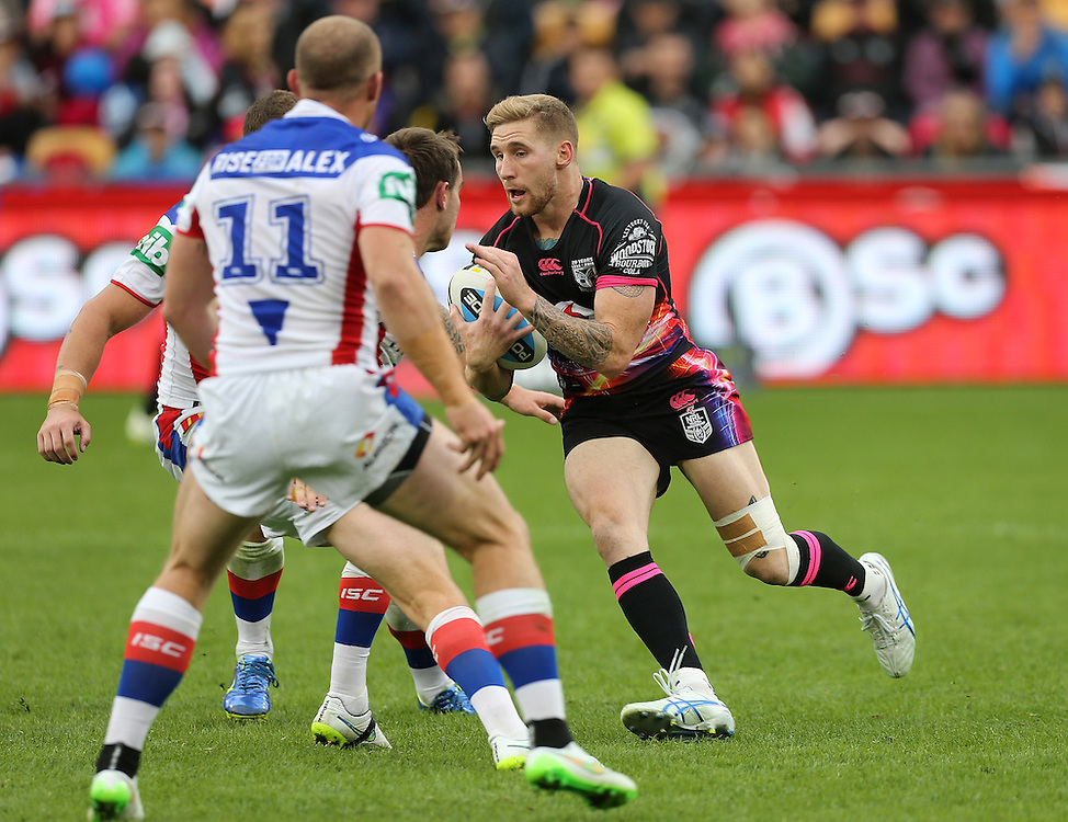 Sam Tomkins of the New Zealand Warriors is challenged by the Newcastle Knights during their round 12 NRL match at Mount Smart Stadium, Auckland on  Sunday, May 31, 2015. Credit: SNPA / David Rowland