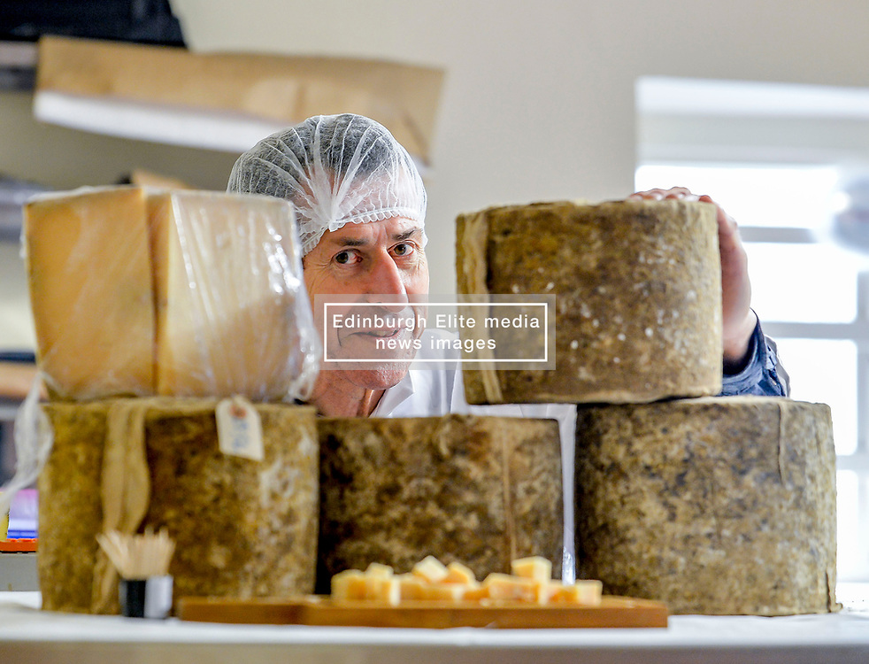 Humphrey Errington, founder of Errington Cheese, with some of the cheeses during the company's public open day, which marked the reopening of the business following an outbreak of E.coli 0157 2 and a half years ago in which a three year old girl died.<br /> <br /> © Dave Johnston / EEm