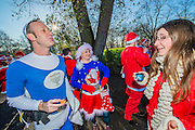 Santa costumes, beer, champagne and sunshine. The annual Santacon walk starts from three locations around london and converges on Hyde Park.Here with the South route starting on Clapham Common.