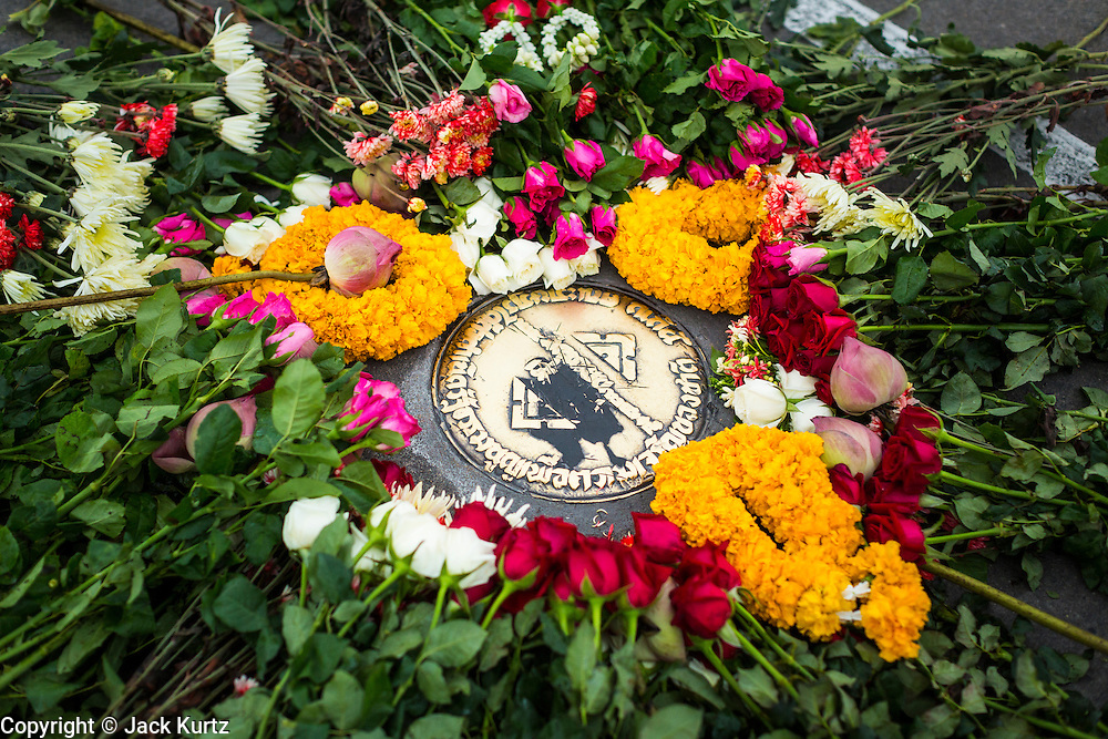 "24 JUNE 2014 - BANGKOK, THAILAND: Roses and flowers on the spot where the ""People's Party"" demanded a constitutional monarchy during a bloodless coup in 1932. The poets  gathered in front of the Anantasamakom Throne Hall Tuesday to pay homage to the People's Party, a Siamese (Thai) group of military and civil officers (which became a political party) that staged a bloodless coup against King Prajadhipok (Rama VII) and changed Thailand (then Siam) from an absolute monarchy to a constitutional monarchy on 24 June 1932. Since the coup against the civilian government on 22 May, the ruling junta has not allowed political gatherings. Although police read the poems, they did not arrest any of the poets or make any effort to break up the gathering.     PHOTO BY JACK KURTZ"
