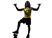one black Brazilian soccer football player man saluting in silhouette studio on white background