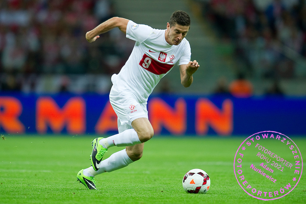 Poland's Robert Lewandowski controls the ball during the 2014 World Cup Qualifying Group H football match between Poland and Montenegro at National Stadium in Warsaw on September 06, 2013.<br /> <br /> Poland, Warsaw, September 06, 2013<br /> <br /> Picture also available in RAW (NEF) or TIFF format on special request.<br /> <br /> For editorial use only. Any commercial or promotional use requires permission.<br /> <br /> Mandatory credit:<br /> Photo by &copy; Adam Nurkiewicz / Mediasport