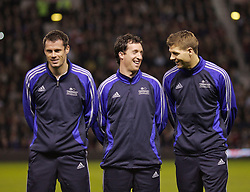 Manchester, England - Tuesday, March 13, 2007: Liverpool players Jamie Carragher, Robbie Fowler and Steven Gerrard share a joke before appearing for a Europe all-star XI against Manchester United during the UEFA Celebration Match at Old Trafford. (Pic by David Rawcliffe/Propaganda)