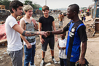 One Direction walking through the Agbogbloshie slum in Accra