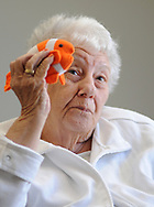 Patient Jeannette Schmauder, 80, holds a stuffed fish as Chaplain Blaik Westhoff (cq) (not shown) speaks about creation during Spirit Alive, a religious service for people with dementia that incorporates Montessori principles Wednesday, June 28, 2017 at Meadow Glen Personal Care in Richlandtown, Pennsylvania. (WILLIAM THOMAS CAIN / For The Philadelphia Inquirer)