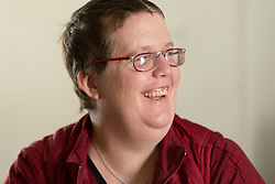 1/27/15 12:51:09 PM -- Louisa, KY, U.S.A  -- Cheryl Castle, a recent recipient of the high-tech device, can now do many tasks she was unable to do when her epileptic seizures became more severe and more frequent. Now she's getting back to a normal life.<br /> <br />  --    Photo by Jonathan Palmer, Freelance