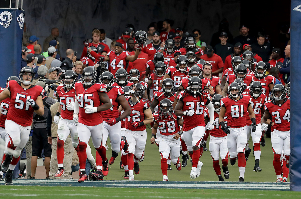 Members of the Atlanta Falcons take the field before an NFL football game against the Los Angeles Rams Sunday, Dec. 11, 2016, in Los Angeles. (AP Photo/Rick Scuteri)