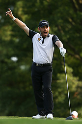 August 12, 2017 - Charlotte, North Carolina, United States - Louis Oosthuizen signals after teeing off the 18th hole during the third round of the 99th PGA Championship at Quail Hollow Club. (Credit Image: © Debby Wong via ZUMA Wire)