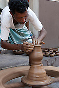 India, pondicherry, Potter works on a potter's wheel