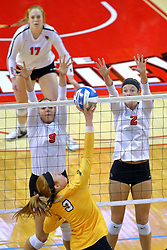 23 November 2017:  Katherine Carlson attacks towards Stef Jankiewicz, Jaelyn Keene and Sydney Holt during a college women's volleyball match between the Valparaiso Crusaders and the Illinois State Redbirds in the Missouri Valley Conference Tournament at Redbird Arena in Normal IL (Photo by Alan Look)