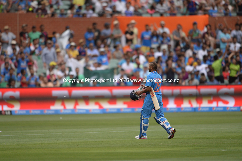 Indian batsman Shikhar Dhawan walks back after getting out during the ICC Cricket World Cup match between India and Pakistan at Adelaide Oval in Adelaide, Australia. Sunday 15 February 2015. Copyright Photo: Raghavan Venugopal / www.photosport.co.nz