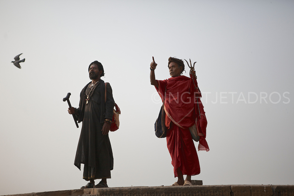 Rahm (L) and Baba G (R), in conversation during a walk along the Holy River Ganges. Varanasi, India.