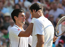 Novak Djokovic consoles Juan Martin Del Potro after his semi-final win   at the Wimbledon Tennis Championships in London, Friday, 5th July 2013<br /> Picture by Stephen Lock / i-Images