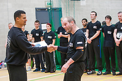 Student receives his certificate passing his P1 grading  from Franklyn Hartkamp at the Institute Of Krav Maga Scotland grading today at Stirling.<br /> ©Michael Schofield.
