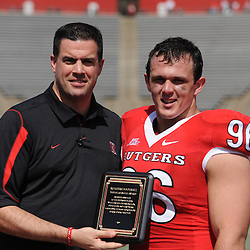 Apr 18, 2009; Piscataway, NJ, USA; Rutgers Athletic Director Tim Pernetti presents Charlie Noonan (96) with the Douglas Smith Award for most improved defensive player from spring practice during half time of Rutgers' Scarlet and White spring football scrimmage.