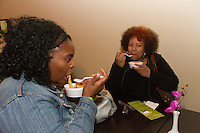 """The Hyde Park Chamber of Commerce held its 2015 Dinner Trek Tuesday evening. Participants were invited to try samples of food from restaurants along 55th and 57th Street between Cottage Grove and the lakefront.<br /> <br /> 0858 – Shundra Johnson and Teresa Tyler enjoy food from Pho 55 Vietnamese Noodle and Grill located at 1611 e. 55th Street.<br /> <br /> Please 'Like' """"Spencer Bibbs Photography"""" on Facebook.<br /> <br /> All rights to this photo are owned by Spencer Bibbs of Spencer Bibbs Photography and may only be used in any way shape or form, whole or in part with written permission by the owner of the photo, Spencer Bibbs.<br /> <br /> For all of your photography needs, please contact Spencer Bibbs at 773-895-4744. I can also be reached in the following ways:<br /> <br /> Website – www.spbdigitalconcepts.photoshelter.com<br /> <br /> Text - Text """"Spencer Bibbs"""" to 72727<br /> <br /> Email – spencerbibbsphotography@yahoo.com"""